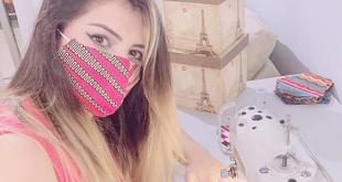 Una mujer refugiada en Brasil confecciona mascarillas de tela.